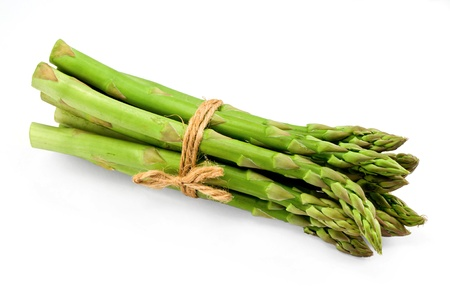 Asparagus bunch a premium seasonal vegetable isolated on a white background with light shadow Stock Photo