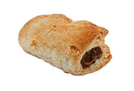 cooked sausage: Freshly baked single sausage roll isolated against a white background a popular pastry snack available hot or cold at bakers in Britain Stock Photo