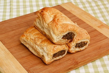 puff: Freshly baked sausage rolls in a traditional setting a popular pastry snack available hot or cold from any English Bakery recently subject to the pasty tax for hot food