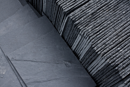 material: Slate roofing tiles in a pallet ready for sale sale as a construction material at a building suppliers