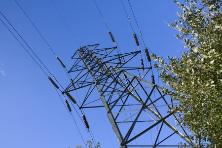 unsightly: Electricity pylons used to distribute national grid energy over land often contested for planning permission being unsightly and polluting the landscape Stock Photo