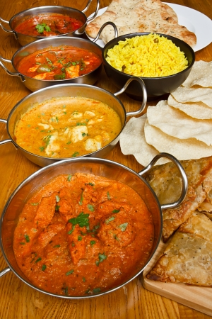 oriental food: Selection of indian curries with pilau rice, naan bread, poppadoms and samosas a popular buffet choice