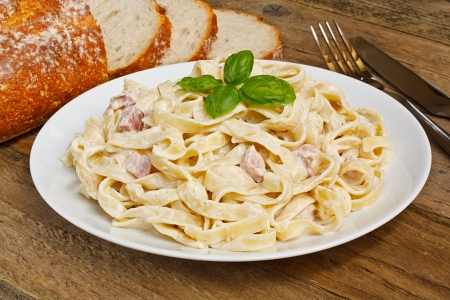 gastro: Plate of tagliatelli carbonara italian food in a rustic restaurant setting