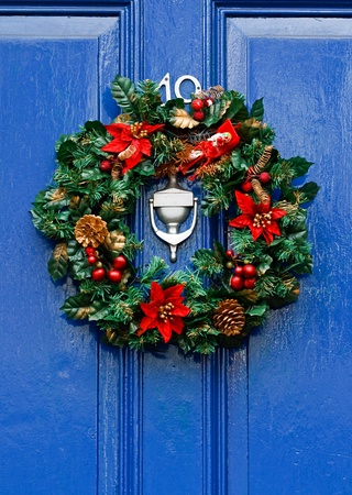 Festive Christmas wreath on door at Christmastime photo