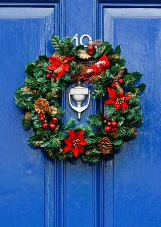 Festive Christmas wreath on door at Christmastime