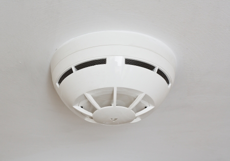 detector: ceiling mounted white fire detector used to activate warning systems in residential buildings