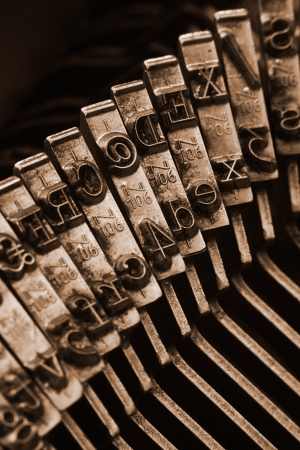 Close up of antique typewriter typebars with focus on the @ symbol, great concept for blogs, journalism, news or the mass media Stock Photo - 23044120