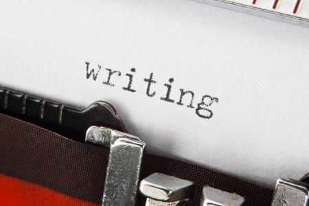 type spelling the word writing on a vintage typewriter, great concept for blogs, journalism, news, authors or the mass media Stock Photo - 23044122