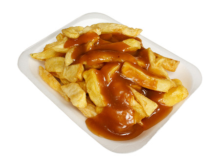 take out: French Fries or Chips and gravy a popular european takeaway snack, served in a polystyrene tray from a take out
