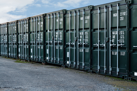 self storage: line of new freight containers being used a a self storage solution