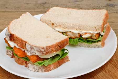simple meal: Fresh Fish Finger Sandwich on a white serving plate Stock Photo
