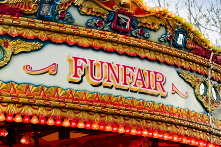 fairs: Traditional Carousel funfair sign on amusement ride found at old fashioned state fairs Stock Photo