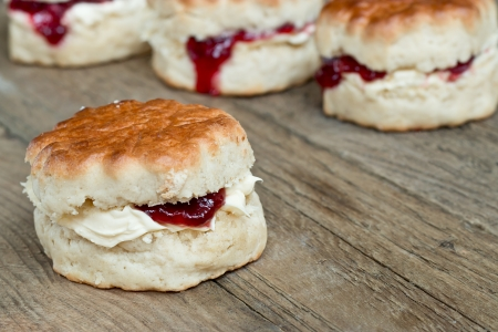 teacake: Cornish Cream Tea of scones filled with clotted cream and strawberry jam often served with hot beverages