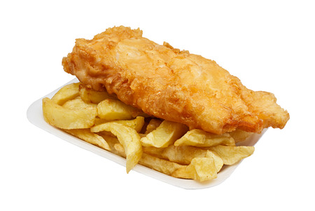 Carton of fish and chips  A traditional British takeaway choice isolated on white