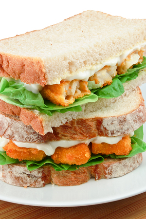 simple fish: Fresh Fish Finger Sandwich close up on a white serving plate Stock Photo