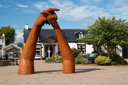 The sculpture in the courtyard at the Old Blacksmith Shop at Gretna Green, Scotland, traditionally made famous in the 18th century as a venue for runaway marriages