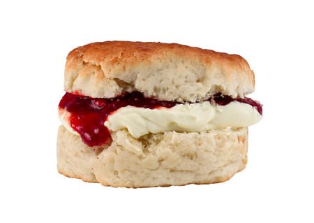 cream tea: Traditional Scone with clotted cream and strawberry jam often served as afternoon tea isolated on white