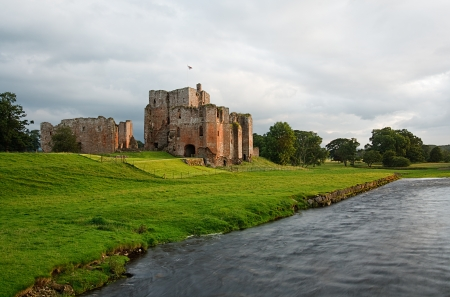 The picturesque Brougham Castle an ancient 13th century fortification next to the river eamont and near Penrith in Cumbria Stock Photo - 24478512