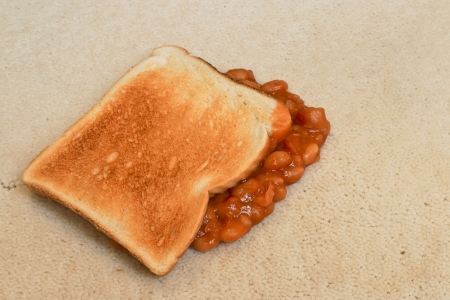second meal: Baked Beans on toast accidentally dropped and creating a carpet stain on beige pile floor covering