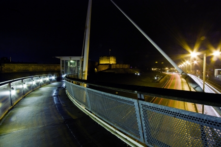 the carriageway: Carlisle Castle at night from the millennium bridge over the Castle way dual carriageway