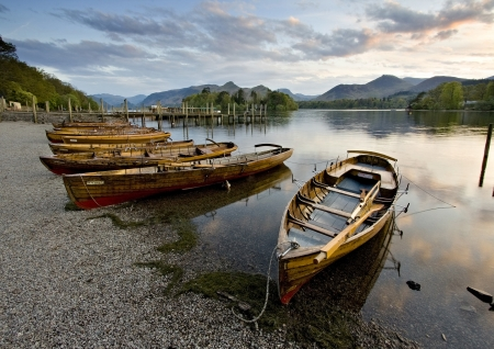 english countryside: Resting Rowing Boats on Derwent Water at Keswick Landing Stage, Sunset