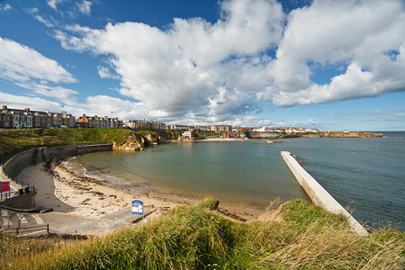 slipway: A sunny day at Cullercoats bay a popular tourist attraction located between Tynemouth and Whitley Bay