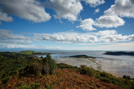 mote: Looking over the Kippford estuary from the Muckle above Kippford  The Mote of Mark, Rockliffe Bay and Castle Hill Point ban be seen to the left  Rough Island is in the middle and Hestan Island can also be seen on the right  In the distance Robin Rigg Wind