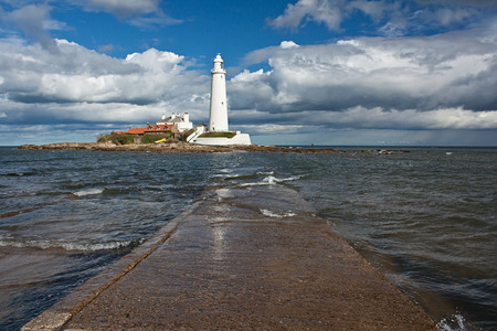 beacons: Flooded Tidal Causeway to st marys lighthouse on the North East Coast of England near Whitley Bay