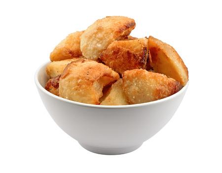 Porzione di patate d'oro arrosto croccante in una ciotola
