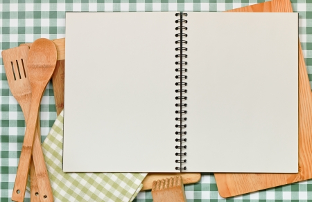 recipe book: Double page spread blank ring binder with copy space  Great recipes backdrop on a green gingham table top with kitchen equipment surround  Stock Photo