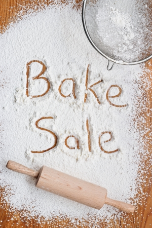 fundraiser: Flour on a wooden table symbolising a Bake Sale Notice Stock Photo