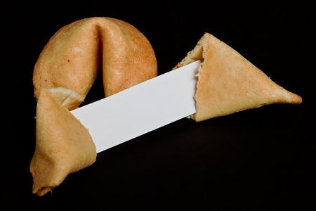prophecy: Chinese fortune cookies on black background with blank paper strip for your own good luck prophecy Stock Photo