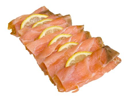 thinly: Smoked salmon sliced and arranged with lemon slices isolated against a white background