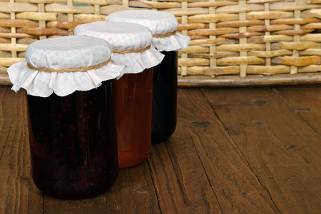 bake sale: Traditional homemade Fruit Jam jars a popular fruit preserve often sold at country fairs and charity bake sales