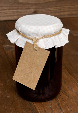 insertion: Mixed fruit jam in a glass jar with traditional cloth lid and blank label for insertion of your message or company branding