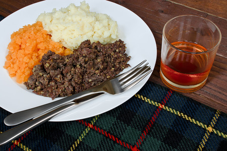 Traditional Scottish haggis, neeps and tatties with whisky also known as a burns supper.