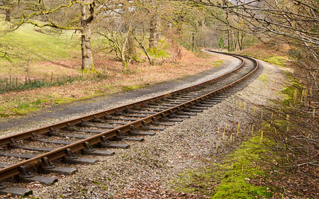 s curve: Heritage railway train tracks forming an S curve through a rural setting.