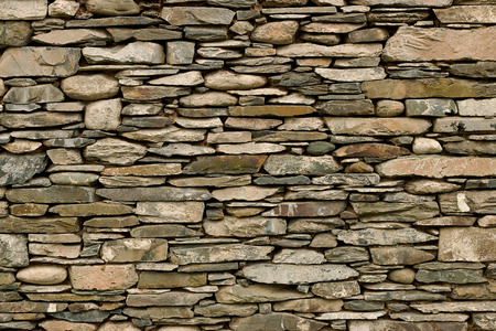 rockwall: Natural stone wall hand crafted by an experienced mason, great background or wallpaper for builders.