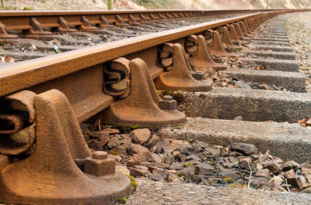 railway history: Heritage rail road train tracks extreme close up and fading into distance.