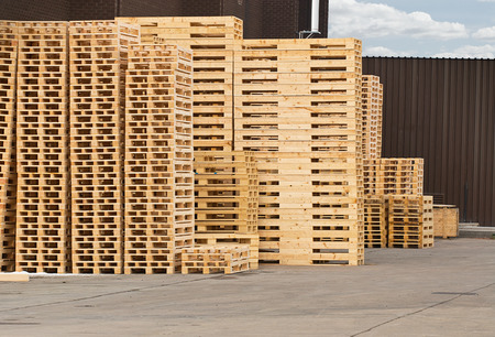 Stock Piles of wooden pallets in a yard ready for breaking up and recycling into firewood or kindling Stock Photo - 27704894