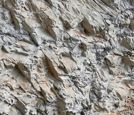 'rock drill': Blasted rock face background texture showing blast and drill markings
