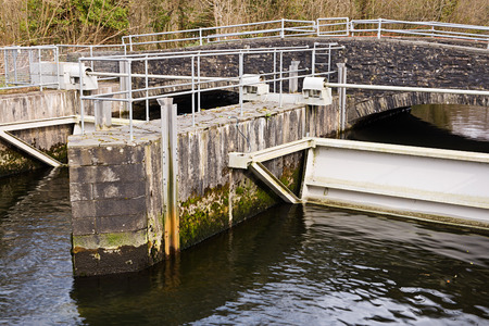 sluice: Sluice gate on a river for damming and controlling water height levels