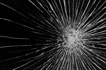 Cracked glass against a black background Stock Photo
