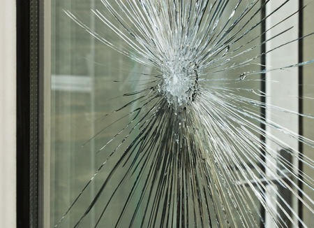 window pane: Broken glass window smashed by accident or after a break in, great for an insurance claim.