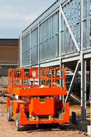 Self propelled diesel engined cherry picker a popular piece of construction equipment leased at plant hire depots for safe work at varying heights photo