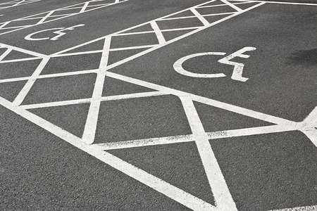 designated: Designated Disabled car parking spaces reserved with white painted lines often set aside to give handicapped people accessibility in a car park.