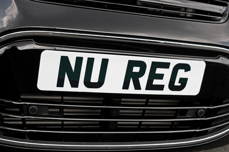 occurs: New Registration plate on a car for sale, symbolising the increase in sales which often occurs after the annual update of reg numbers.