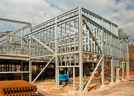 steel beam: The skeleton frame of a Steel framed building showing the vertical steel columns and horizontal I beams on a new Commercial property Office development.