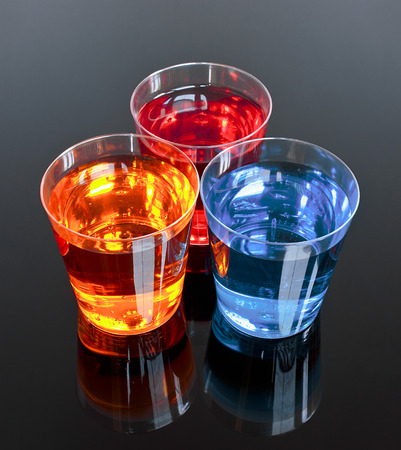 Three shots on a black background perfect for promotions or offer in the alcoholic drinks industry