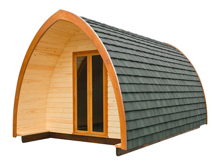 Wooden log cabin often used as a holiday lodge for glamping holidays isolated on a white background Standard-Bild